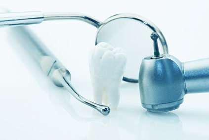 Healthy teeth concept. Real human wisdom tooth and dental tools. Blue tinted image